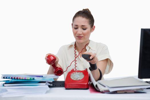 Busy secretary hanging up