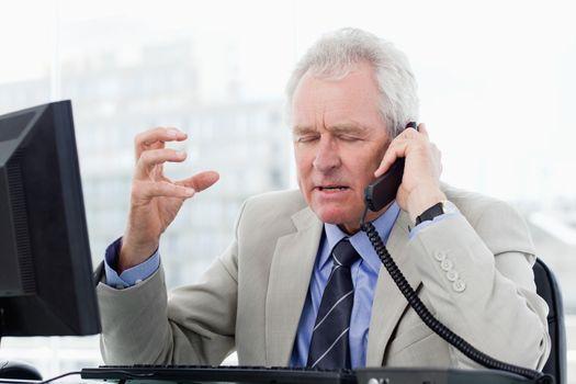 Irritated senior manager on the phone