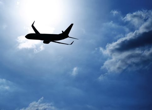 Silhouette airplane in blue sky