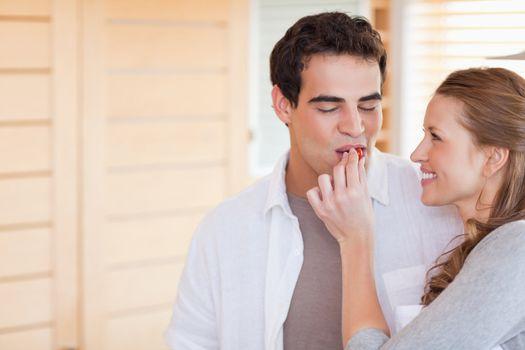 Woman feeding her boyfriend