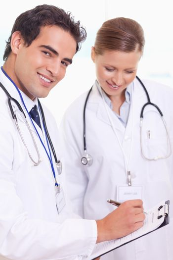 Assistant doctors with patient record