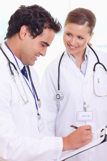 Doctors analyzing patient record