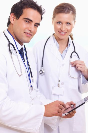 Assistant doctors with tablet