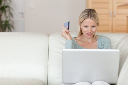 Woman on the sofa booking holidays online