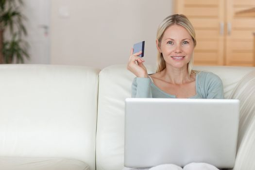Woman on the couch booking holidays online