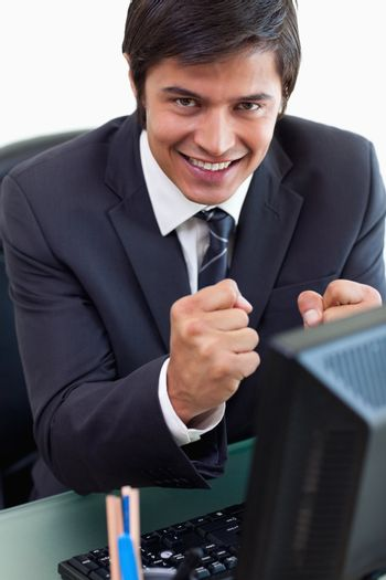 Portrait of a satisfied businessman working with a computer