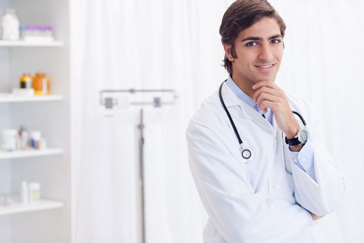 Doctor standing in his examination room