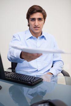 Businessman handing over paperwork