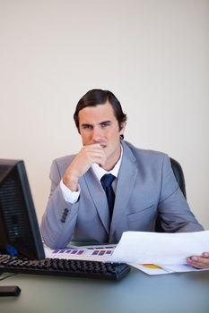 Salesman thinking about statistics