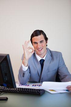 Businessman approving paperwork