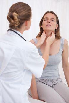 Doctor examining patients throat