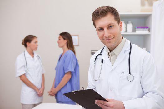 Doctor standing in examination room
