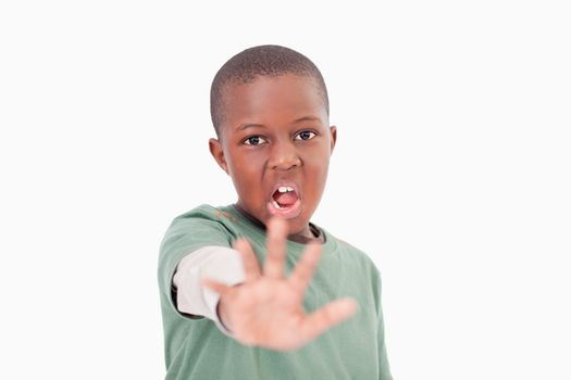 Boy saying stop with his hand