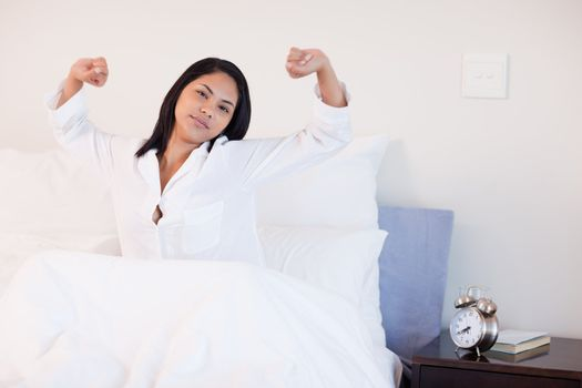Woman stretching to wake up