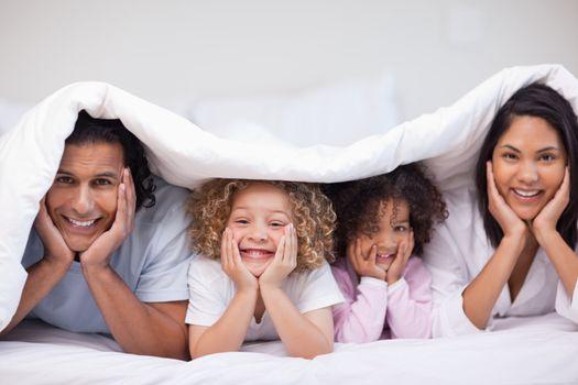 Family hiding under the blanket
