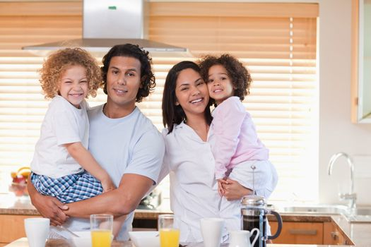 Family having breakfast in the kitchen together