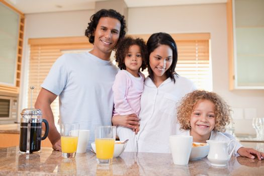 Happy family having breakfast in the kitchen together