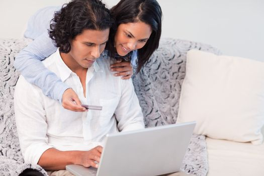 Couple booking holidays online