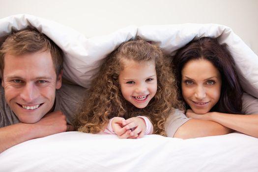Family hiding under their blanket