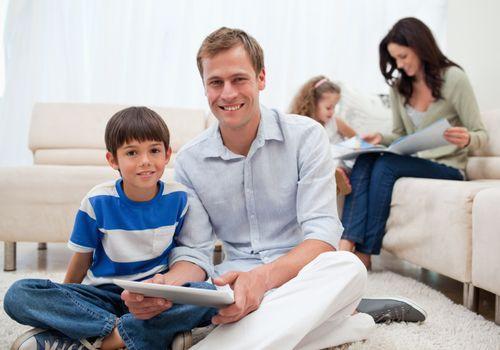 Family spending free time in the living room