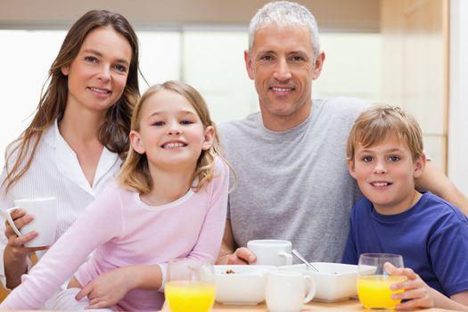 Family having breakfast in their kitchen
