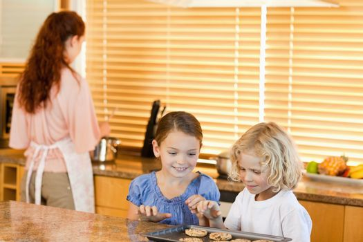 Siblings stealing cookies together