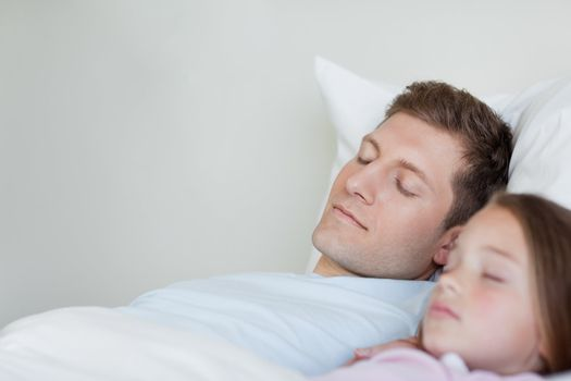 Father and daughter taking a nap