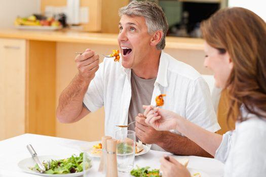 Married couple enjoying dinner