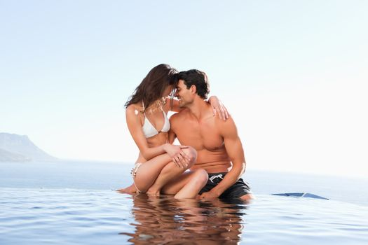 Couple on the pool edge