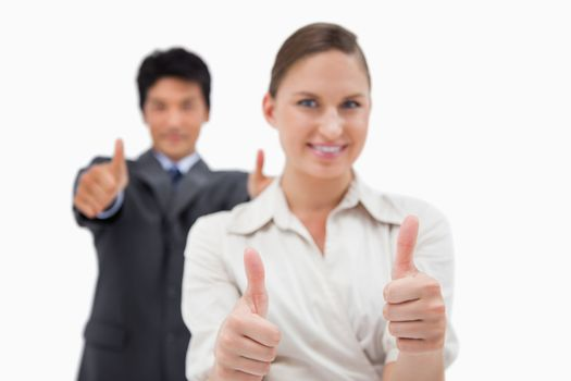 Smiling business people with the thumbs up
