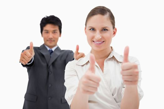 Business people with the thumbs up