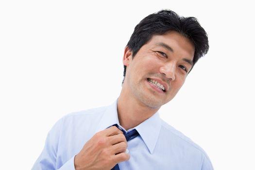 Businessman removing his tie