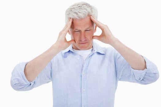 Exhausted man having a headache
