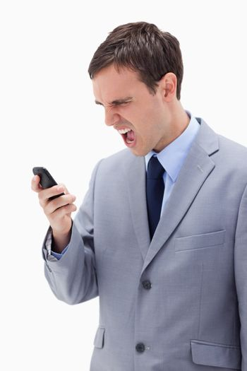 Businessman yelling at his cellphone