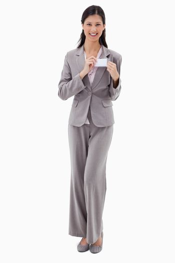 Businesswoman putting on name badge