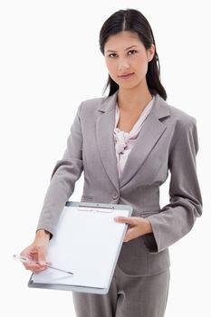 Businesswoman asking for signature