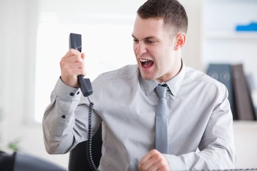 Businessman yelling at the phone