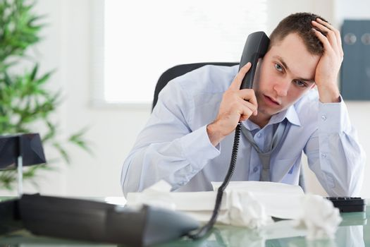 Troubled businessman on the phone