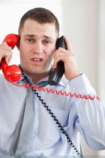 Close up of businessman troubled by the telephone