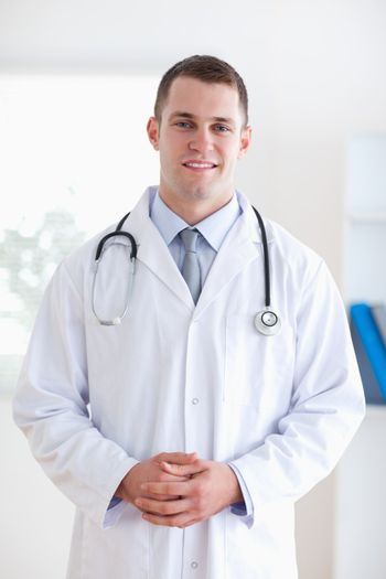 Doctor with fingers folded