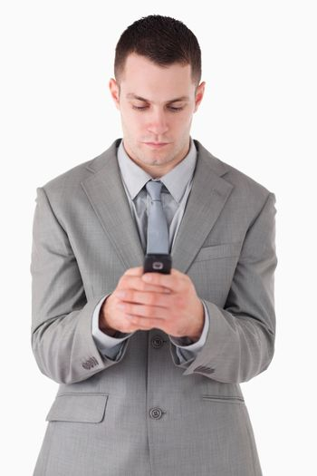 Portrait of a businessman dialing on his cellphone