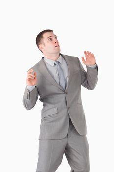 Portrait of a surprised young businessman
