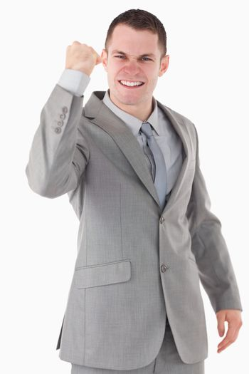 Portrait of a businessman with his fist up