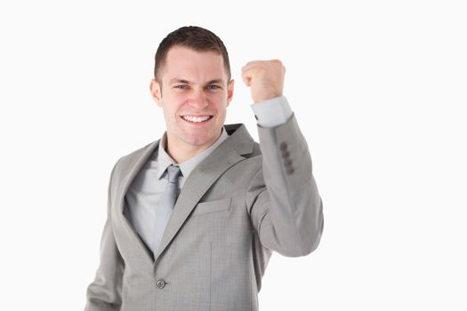 Young businessman with his fist up