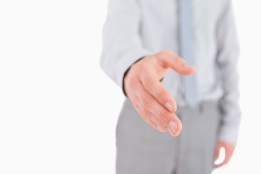 Businessman giving his hand