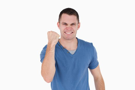 Smiling man with the fist up