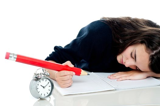 Exhausted schoolgirl dozing off