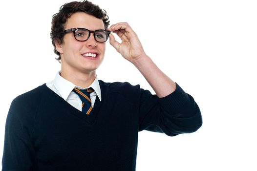 Smiling student adjusting his spectacles