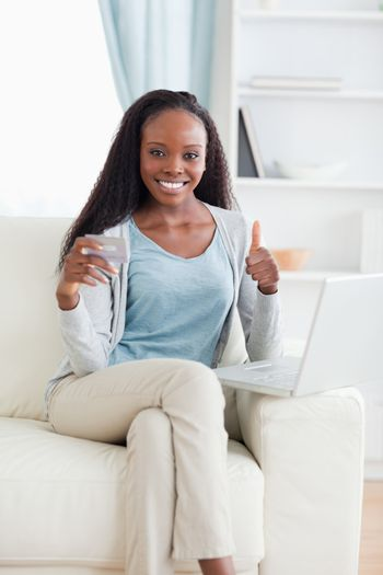 Woman satisfied with online shopping