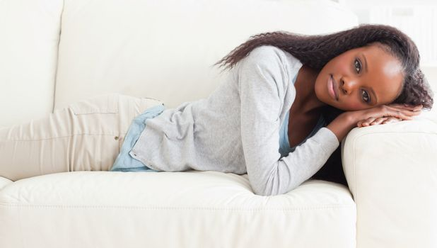 Woman about to take a nap on the sofa